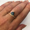 teal trilliant sapphire ring
