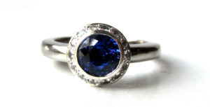 Recycled Platinum Engagement Ring with Small White Sapphire Halo and a Beautiful Ceylon Blue Sapphire