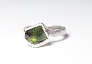 18ct Fairtrade gold with custom cut sapphire by Zoe Pook Jewellery