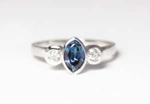 18ct Fairtrade gold with sapphire and diamonds by Zoe Pook Jewellery