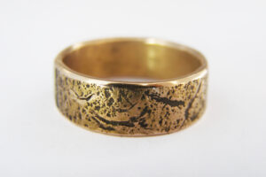 Textured yellow gold wedding ring